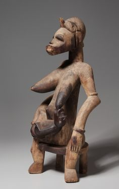 Mother-and-Child Figure, 1800s-1900s      Africa, Guinea Coast, Ivory Coast, Senufo people, 19th-20th century      wood, Overall - h:63.60 cm (h:25 inches).