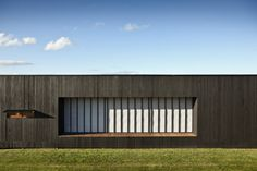 The Tutukaka Beach House makes use of moveable shutters to control the light and temperature inside and reduce energy use.