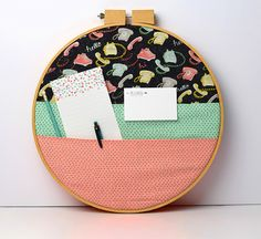 Make a cute - no sew - organizer with an embroidery hoop and our Talk to Me fabric! Don't forget the Pixies!!!! :)