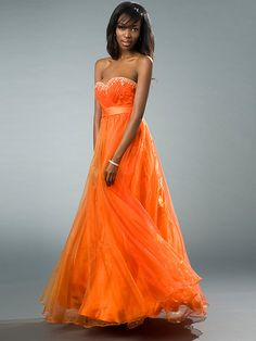 Long & Flowing for prom, love the ruffles at the bottom, can imagine this one twirling around the dance floor all night long!