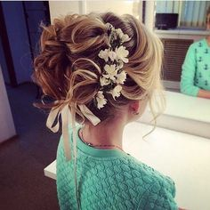 wedding hairstyle updo 4 via antonina roman / http://www.himisspuff.com/beautiful-wedding-updo-hairstyles/11/