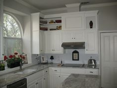My kitchen! Bianco Romano Granite.  Added shelves above existing oak cabinets and painted it all creamy white!