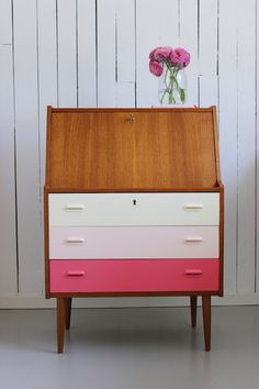 Upcycle an old chest of drawers by painting the draws in an ombre of pink shades.