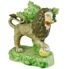 Staffordshire Model of a Lion | From a unique collection of antique and modern pottery at http://www.1stdibs.com/furniture/dining-entertaining/pottery/