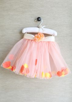 """Pretty And Precious Tutu  38.99 at shopruche.com. Sweet and adorable, this pink tulle tutu features rose petal accents in twilight hues of yellow, peach, and orange. Perfected with an elasticized waist, delicate rose detail, and cream satin tie. Includes a drawstring storage bag.  90% Polyester, 5% Satin, 5% Silk, Made in USA, 12"""" length from top of waist"""