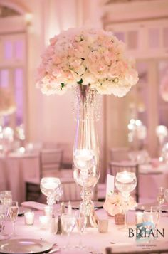 Beautiful all white elegant centerpiece. See more at flowersbybrian.com
