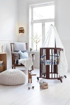 Stokke sleepi in walnut with pretty blue silhouette bedding.  Just lovely