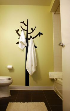 Paint the tree and add the hooks, cute for kids bathroom.