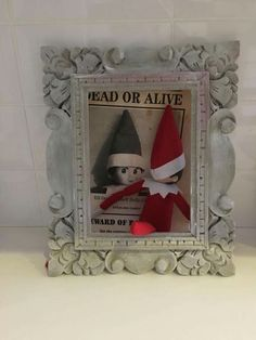 #Elfontheshelf December 13: Holly says that she has (quite literally) been framed for the candy theft. Besides, she adds, she looks NOTHING like that elf on the wanted poster. To prove it, she posed alongside it. See? No resemblance whatsoever.