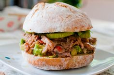 pulled pork burger with tomato sauce and avocado salsa