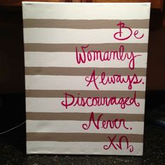 Be womanly always.  Discouraged never.  Chi Omega.