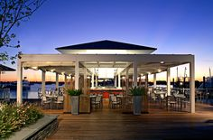Watch the sunset over the bay on Forty 1 North's deck.