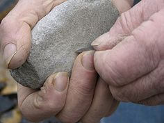 Flint knapper's hands, a skill from thousands of years ago.
