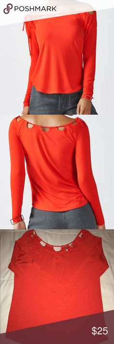 Carla Long Sleeve Tee- Ember This top is a silky, soft cotton jersey fabric with a scalloped edge boatneck and tie on side. It is stretchy, breathable, adjustable, semi-fitted and true to size. I wore this ember top only once. Fabletics Tops Tees - Long Sleeve