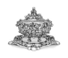 AN ITALIAN SILVER SOUP TUREEN ON STAND