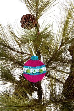 Felt tree ornament. Use sticky jewels and sticky back felt shapes to decorate. Jewellery finding at top to finish and hold thread? Need to try it....