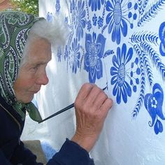 Agnes Kasparkova, a 90-year-old agricultural worker, passes her spare time painting floral motifs on houses in the Czech village of Louka.