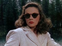 The color throughout the movie is beautiful, a dreamy palette of teal and white, but to me this film is all about Gene Tierney. Specifically in the infamous boat scene above.    She embodies the perfect idea of 1940′s fashion.  Great hair, perfect makeup, gorgeous sunglasses, and of course big shoulders. Not to mention she plays a great femme fatale.