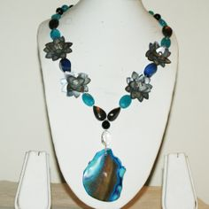 Large Blue Volcanic Pattern Agate Pendant Necklace with co-ordinated stones and decorative flower embellishments. Beautifully Different!