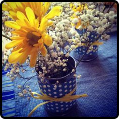 Yellow daisies with baby's breath in blue vases