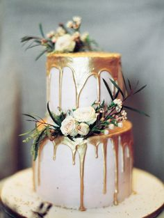 Fruitty Lemonade cake, Iced in Strawberry Meringue, Decorated in dripping White Chocolate Ganache, that is painted with edible metallic gold.