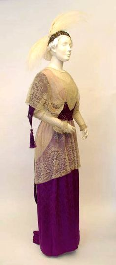 Lace and purple silk dinner dress, probably made by Toronto dressmaker, ca. 1913. The headdress is a bandeau of gold beads and amethyst glass stones set onto gold cloth stretched over a wire frame with two egret feather wings. Fashion History Museum Facebook