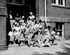 From the Archives: Kids pour out of Omaha's Webster School to start 1949 summer vacation