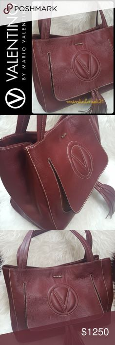 Valentino Italy Leather Tote Bag NEW!!! Valentino by Mario Valentino Designer Purse in Stunning Pebbled Leather Tote Shoulder Bag! Features Rare Collection Line of Valentino Ollie in Gorgeous Red Wine Burgundy Shade! Contrast Stitching Details Throughout!  Made in Italy with Soft Pebbled Leather Exterior and Gold Metal Lettering  Valentino Logo! Oversized Quilted V Logo at Tasseled Flap Front! Top Quality Designed with Top Snap Button Closure Opens to Fully Lined Interior! Last Pictures (Red