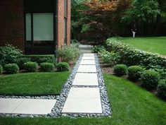 """Walkway - Practical combination of """"stepping stones"""" and river rock. Great way to reuse our slate from the back to a walkway on the side"""