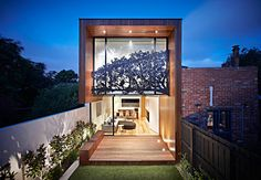Treetop House, Melbourne by MGA+D.  The rear facade of an extension the an old Victorian house.  The hand-carved, zinc-coated aluminium screen is a poetic response to a tree that was cleared during the renovation. The screen is more than just an embellishment and artwork, it also fulfils the requirement for 75% opacity for a window that looks onto its neighbours.
