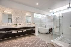 Mid Century Remodel midcentury-bathroom - The Cream 1x1 Mother of Pearl tile on wall behind the sink.  White 4x12 Subway tile in the shower.  Gorgeous!! https://www.subwaytileoutlet.com/products/Cream-1x1-Pearl-Shell-Tile.html#.VRLfbY7F-1U https://www.subwaytileoutlet.com/products/White-Glass-4x12-Subway-Tile#.VRLkA47F-1U
