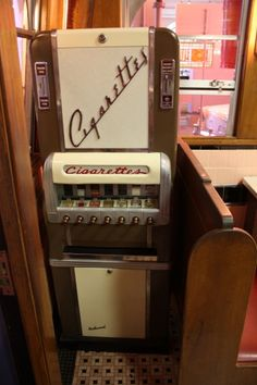 Cigarette vending machine.  These machines were everywhere. Kids could buy cigarettes (for their parents, of course).