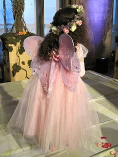 We had wings & a wand for the little flower girl. It is a midsummers night dream. Dont want to forget the crown of flowers