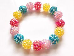by Sweet Pink Daydream on etsy. This sparkly fairy kei pastel cluster beaded bracelet makes your outfit look super fancy ^.^