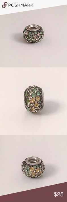 Chamilia jeweled kaleidoscope bead Green/yellow/gold Swarovski crystals surround this Sterling silver Chamilia bead. Very beautiful. Will consider reasonable offers. Chamilia Jewelry