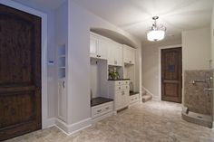 Like that there are 2 separate benches and larger cabinet in the center | Spur Road - Edina, MN traditional entry