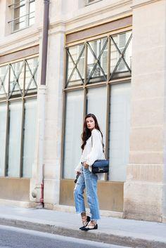 PARIS ON FOOT Peony Lim: white loose pirate blouse, ripped denim boyfriend jeans, sadle bag, strap-up flats, sunglasses, silver metallic belt