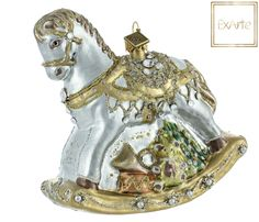 Szklane bombki choinkowe.  Silver horse with golden mane, gold harness and golden rocks, decorated with crystals and pearls. Underneath it hides toys: teddy bear, Christmas tree, drum and trumpet. The colours are entirely subdued and glittery details emphasize the metallic sheen of background.