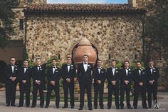 Check out this groom and his groomsmen in traditional black tuxes. | Bella Collina