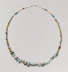 Beaded Necklace, early 6th century, made in Niederbreisig, Frankish, Glass, glazed earthenware (faience); Dimensions: Overall: length of string 28 1/4 x 1 in. (71.8 x 2.6 cm) Bead diameter: From 1 to 3/16 in. (2.6 to 0.4 cm) Bead length: From 13/16 to 1/16 in. (2 to 0.2 cm)