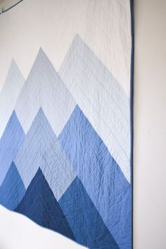 Misty Mountains quilt pattern uses big cuts of fabric and a bold geometric piecing for maximum effect. The quilt pattern comes with instructions for 3 sizes - wall hanging Modern Quilting Designs, Modern Quilt Patterns, Quilt Patterns Free, Modern Baby Quilts, Beginner Quilt Patterns, Simple Quilt Pattern, Denim Quilt Patterns, Triangle Quilt Pattern, Modern Quilt Blocks