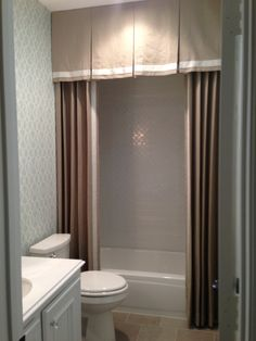Beautiful shower curtain in a remodeled bath