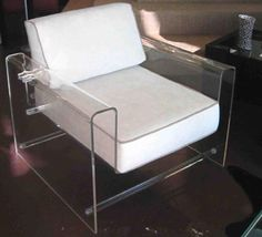 MONROE CHAIR by AARON R. THOMAS  Materials: Clear acrylic with upholstered cushions Dimensions: 32W x 32D x 29H (18 seat height)  Options: Ultra suede, wool, mohair, leather, cowhide fur / Clear, color, or frosted acrylic