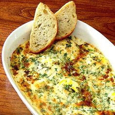 Dragon's Kitchen: Herb Baked Eggs - these were delicious, quick, and easy! I halved the recipe (perfect amount for two) and made it all in one oven-safe dish rather than the individual gratin dishes. Sprinkle a little extra cheese on top when they come out of the oven :)