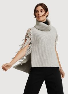 Meet the Fringe Benefits Poncho.   Kit and Ace – note the interesting straight column in front for the increasing.