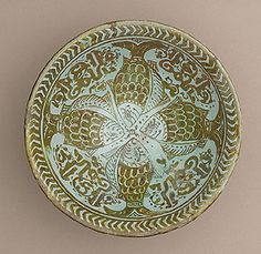 Bowl Egypt, twelfth century Earthenware, overglaze luster painted 2 9/16 x 6 13/16 in (6.51 x 17.3 cm)  Accessed 3/22/14  This bowl shows some typical features of Islamic pottery:  luster paint, vegetal and zoomorphic (fish) patters, calligraphy and symmetry.