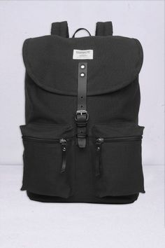 SANDQVIST ROALD BLACK by Kin of Skin 100 polyester adjustable shoulder  strapsWebbing carry handlesPadded back panelZippered main compartment and  front ... 2a52109cb48be