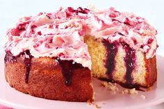 Impress your family and friends with this delicious lemon poke cake, made with a warm blueberry sauce and topped with a zesty buttercream icing.