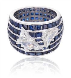 A sapphire and diamond ring, with butterfly shaped diamonds