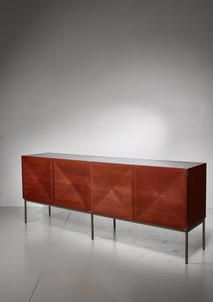 A 'Pointe de Diamant' sideboard designed by Antoine Philippon & Jacqueline Lecoq in 1962 andmanufactured by Behr, Germany.  The sideboardis made of dark teak with maple inside and stands on a steel base. It has four diamond shaped doors and has shelves and two drawers inside.  Excellent condition and stamped by Behr.  We also have a pair of matching highboards available.